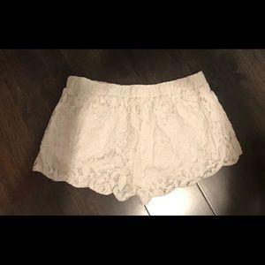 White/cream floral stretch shorts